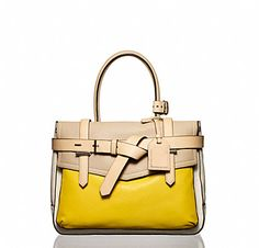 Read Krakoff handbag in cream/yellow.  To add a nice pop of color to any ensemble...