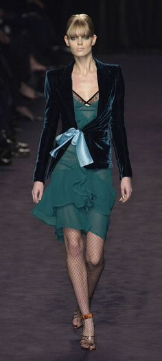 """YSL Ready To Wear Autumn 2003. Tom Ford for Rive Gauche. I remember just wanting to dive into the richness of this velvet jacket and silk bow. Sarah Jessica Parker had one. At the time I didn't know that """"le smoking,"""" velvet, and bows were the signatures of St Laurent."""