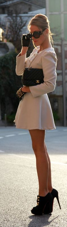 So feminine and cute! White mini dress and heels. Women's street style fashion