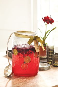 A beverage jar is an easy way to set up a bar for your holiday party and let guests serve themselves!