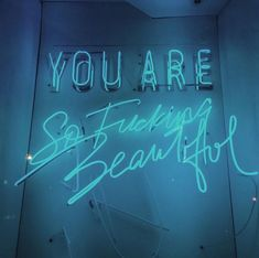 You are so fucking beautiful // blue neon hand written calligraphy sign
