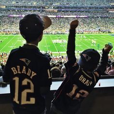 """Pin for Later: Stars Share Their Super Bowl Spirit in Fun Social Snaps  Gisele snapped a picture of her and Tom Brady's sons cheering him on. """"Lets go daddy!! Let's go Pats !!"""" she wrote."""