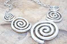 Chunky metal swirl necklace.