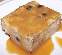 Cuban Bread Pudding  1 loaf Cuban bread  4 whole eggs  2 1/2 cup milk  1 cup granulated sugar  2 tspn vanilla extract  1 tspn cinnamon  1 cup butter (melted)  2 tspn dark rum  2 tspn vino seco (dry white wine)  1 cup raisins  1 grated peel of lemon  1/2 tspn salt