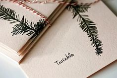 A single pine branch is printed onto textured, pillow soft pink cover weight paper. Each card measures 4.25 x 5.5 and comes with a matching envelope. The i in twinkle twinkles in gold glitter.