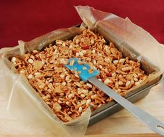 Breakfast Cereal Bars - i did this with natural honey and natural peanut butter in wax paper lined muffin tins for individual servings. looks good so far!