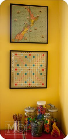 Mount old board games on the wall as playroom decor...  (Plus, note the cute jars ;)