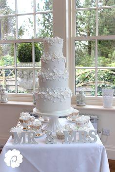 A fresh summery white on white blossom wedding cake