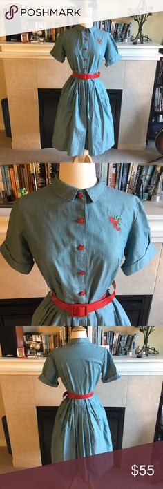 """Cutest Vintage 1950s Chambray Dress ❤️By Dutchmaid Euphrates, PA ❤️100% Cotton ❤️Cute Peter Pan Collar ❤️Red Buttons Down the Front, Trimmed in Red Thread ❤️Cute Strawberry Embroidery on Right Lapel  ❤️Original Red Vinyl Belt ❤️Full Pleated Skirt ❤️Great Vintage Condition except for slight overall fade and a small rust stain on the skirt   MEASUREMENTS ✨Bust measurements: 36"""" ✨Waist: 28"""" Can be cinched smaller with belt ✨Bodice: 15"""" ✨Hip: Full ✨Length: 39.5"""" Dress is shown over a tulle…"""