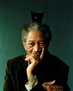 Morgan Freeman with an adorable cat peeking out to say hello. Too cute!