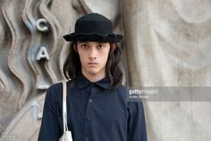 Model Louis Kurihara wears Limi Feu with Y's bag, and a Vintage hat on day 5 of Paris Fashion Week Menswear Spring/Summer 2016 on June 28, 2015 in Paris, France.