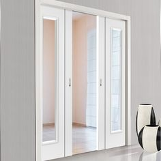 Double Pocket Eco Parelo Satin White sliding door system in three sizes with Clear Glass. #contemporarypocketdoors #whitepocketdoors #glazedpocketdoors