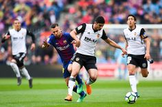 Gonzalo Guedes of Valencia CF competes with Jordi Alba of FC Barcelona during the La Liga match between Barcelona and Valencia at Camp Nou on April 14, 2018 in Barcelona, Spain.