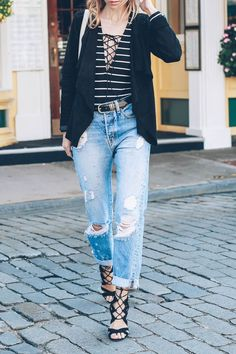 Jess kirby wears a Bernardo suede jacket with Lioness stripe bodysuit, AYR the Form jeans,  and Sam Edelman Lace Up Heels