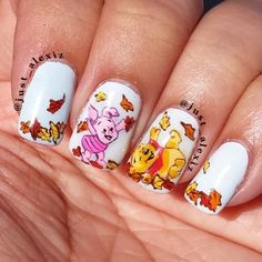 Instagram photo by just_alexiz - Pooh bear and Piglet. Lately, I've no desire to do any nail arts. I just gotten bored with it. I even trimmed my nails, that's how much I didn't feel like designing. Hopefully, Pooh bear and some Thanksgiving designs can get me back to loving nail arts again. This is also the first time I've taken a pic outside.