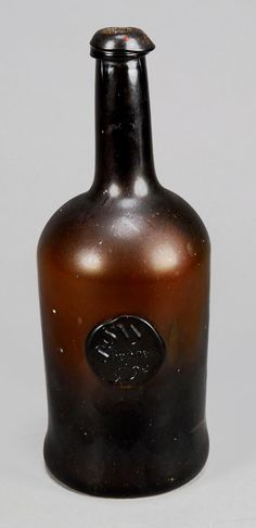 227A: An olive-green tint sealed and dated wine bottle, : Lot 0227A