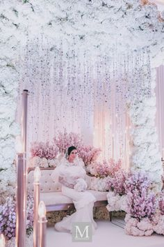 White floral wedding arbour, pink cherry blossoms, rose gold candle lights and suspended crystals // White and pink wedding decor and styling inspiration
