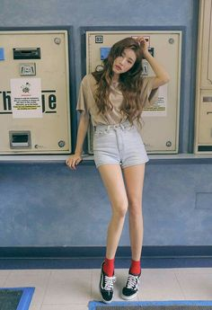 Nude top and denim short plus classic vans with red socks