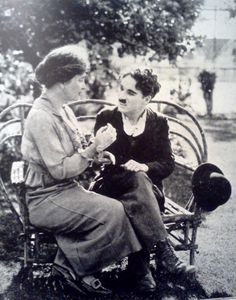 Helen Keller teaching Charlie Chaplin the manual alphabet ca. 1919