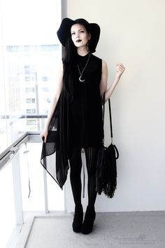 DesperateHell - In love with the flowy black top with black leggings and a wide-brim hat. I need to get me a crescent moon necklace!