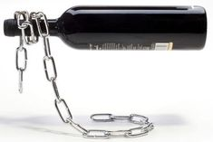 Confuse your brain while storing your wine bottles with this clever metal chain bottle rack. The metal chain appears to be loosely hanging, but it is actually. Bottle Rack, Wine Bottle Holders, Wine Bottles, Bottle Display, Cool Gifts, Unique Gifts, Wine Stand, Deco Originale, Gifts For Wine Lovers