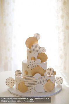 Ivory wedding cake embellished with gold and white abstract circles