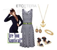 Etcetera's ADVENTURE dress is not only a great day dress, but but it's also a fun 'Sex in the City' girl's night out dress when you add heels and dangly earrings.