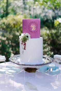 "From the editorial ""This Is the Perfect Blueprint for a Romantic Garden Wedding."" How cute is this cakes gold monogram that read ""We Do?!"" Photography: @samanthajeanbecker #weddingcake #weddingmonogram #weddingcakeideas #fuchsiacake #colorfulcake"