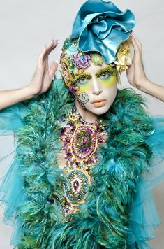 Inspired by - Editorial. Extreme Glam. Turquoise, green, yellow purple. Multiple types of feathers, silk headpiece, face jewels, statement bib necklaces.