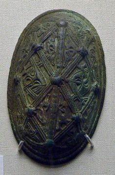 Viking Oval Brooch, 9thCCopper alloy oval brooch, pair to no 2: single shell construction; cast lattice-work frame decoration, bossed at intersections, containing Style III profile animal interlace; textile impressions on back from  casting processFound: Norway, Hordaland, Gjerstad, Maele Farm