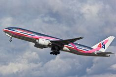 A picture of a Pink Ribbon special livery American Airlines Boeing 777-223(ER) plane taking off from Los Angeles (LAX/KLAX). The aircraft registration is N759AN