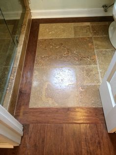 Beautiful custom wood and Versi pattern travertine inlay in Master bathroom! I love how clean, simple and peaceful this bathroom turned out! Installed and designed by 714 Flooring inc. Anaheim Hills Ca