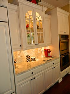 Cabinets, floor, counters, backsplash,  appliances, and sink -Sheldon http://www.thekitchensofsk.com/sheldon.html
