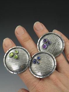 "3 ""saucer"" rings by Michele Grady.  Love everything she does!"