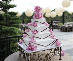 Beach Destination Garden Gold Ivory Pink Purple White Centerpiece Food Outdoor Reception Square Wedding Cakes Photos & Pictures - WeddingWire.com