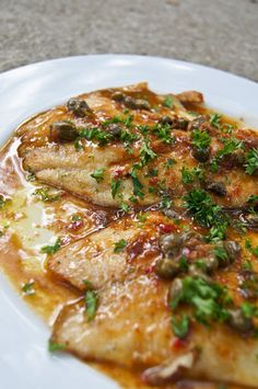 Fish In Caper Lemon Sauce With White Fleshed Fish, Tilapia Fillets, Flour, Black Pepper, Unsalted Butter, Extra-virgin Olive Oil, Capers, Anchovy Paste, Minced Garlic, Dry White Wine, Lemon, Chili Paste, Flat Leaf Parsley, Sea Salt, Ground Pepper