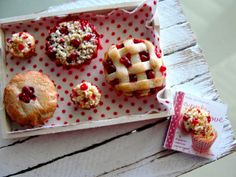 Miniature tray of mini cherry pies and crumb muffins