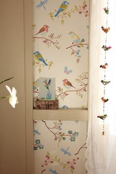 I know this has got to be vintage wallpaper... LOVE the birds...