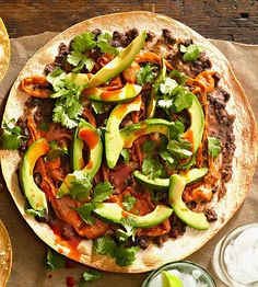 Temper the heat in this sensational Mexican-style pizza with smooth, buttery sliced avocado. Our spicy chorizo-studded queso fundido cheese sauce gives this easy pizza its bold flavor.