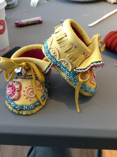 Sioux style baby mocs with eastern woodland bead style by Sadie Thompson