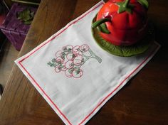 machine embroidered tomatoes from a sauce boat