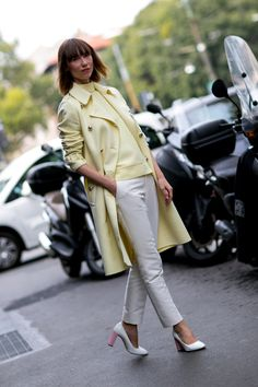 Reach for a yellow coat and beige skinny pants if you're going for a neat, stylish look. Finish off your look with white and pink leather pumps.  Shop this look for $134:  http://lookastic.com/women/looks/yellow-turtleneck-and-yellow-coat-and-beige-skinny-pants-and-white-and-pink-pumps/3884  — Yellow Turtleneck  — Yellow Coat  — Beige Skinny Pants  — White and Pink Leather Pumps
