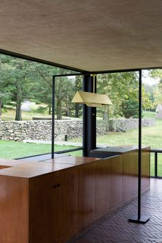 Among the design is gable pendant, which mimics the appearance of an artwork stand featured in the Glass Houses living room.