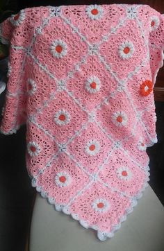 Pink Daisy Crocheted Baby Blanket | FaveCrafts.com ~ intermediate skill ~ FREE CROCHET pattern for this fuzzy blankie.
