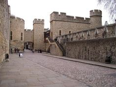 """Tower side view, area where executions were carried out. Anne's room is said to overlook this area, although whether she could/did see the men executed who were condemned with her is unknown. Also housed in this area were kings Richard II, Henry VI, the Princes in the Tower, Lady Jane Grey (""""the 9 days queen""""), Mary, Queen of Scots, and for a period of time, Elizabeth I (Anne's daughter)."""