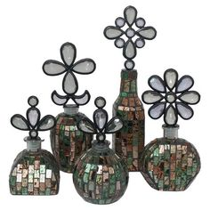 Set of 5 bottles with glass mosaic-inspired designs and jeweled lids.     Product: Extra small bottleSmall bottle