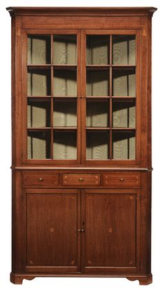 Southern Federal Tassel Inlaid Walnut Corner Cupboard - Probably Washington County Tennessee, 19th century, rope and tassel inlaid frieze over two eight pane glazed doors, shelved interior with silk lining, over an inlaid dovetailed drawer flanked by two false drawer facings, above two fan and quarter fan inlaid panel doors, 90 x 48-1/2 x 22 in.