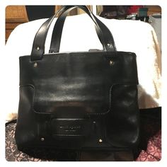 Kate Spade tote Black leather Kate Spade medium tote in excellent condition.  Thick comfortable handles with a slight opening at each end of the zipper closure. kate spade Bags Totes