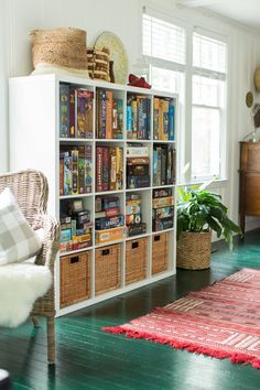 The shelving, also from IKEA, houses Manny's impressive board game collection. The rug was purchased in Morocco.