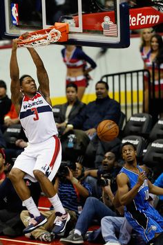 Bradley Beal #3 of the Washington Wizards dunks over Ish Smith #10 of the Orlando Magic during the second quarter at Verizon Center on December 28, 2012 in Washington, DC